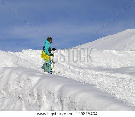Skier On Off-piste Slope In Sun Day