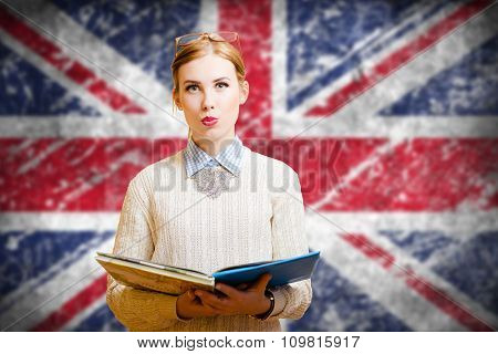 Student girl on english union jack blurred background
