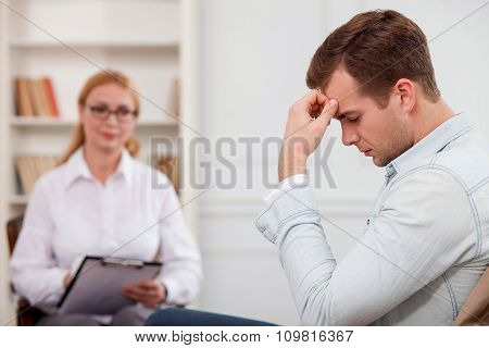 Upset guy is sharing his feelings to therapist