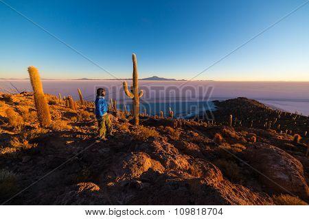 Tourist Watching Sunrise Over Uyuni Salt Flat, Bolivia