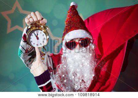 Funky Santa Claus with alarm clock wearing heart shape sunglasses