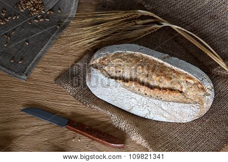 Loaf of bread on a wooden background