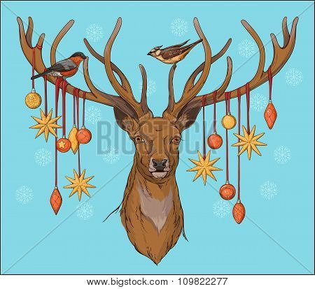close-up view of deer head with horns, birds and christmas decor
