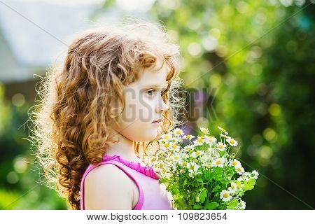 Happy Child In A Field With A Bouquet Of Daisy. Toning Photo.