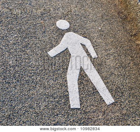 Pedestrian sign on sandyconcrete texture