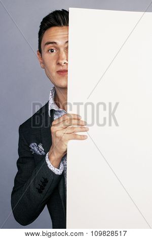 young handsom businessman in suit with poster empty copy space smiling