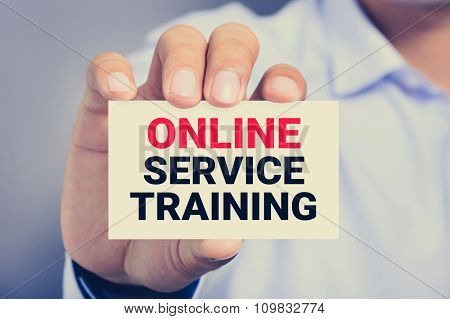 Online Service Training, Message On The Card Shown By A Man