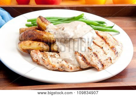 Grilled Chicken With Mushroom Sauce And Fingerling Potatoes