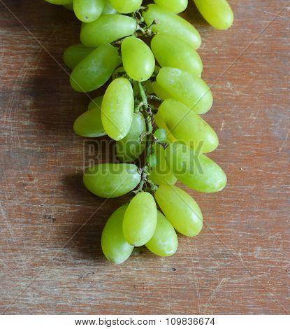 green grape on wooden board