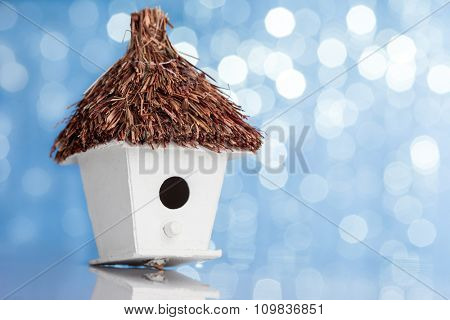 house with a thatched roof on a festive background