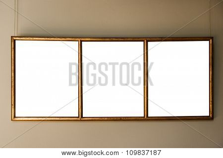 gold antique frame on the wall