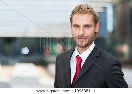Smiling handsome businessman portrait