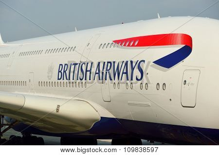 HONG KONG - NOVEMBER 22, 2015: British Airways A380 docked in Hong Kong Airport. British Airways, often shortened to BA, is the flag carrier airline of the United Kingdom.