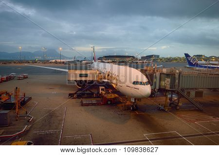 HONG KONG - NOVEMBER 16, 2015: jet flight docked in Hong Kong Airport. Hong Kong International Airport is the main airport in Hong Kong. It is located on the island of Chek Lap Kok