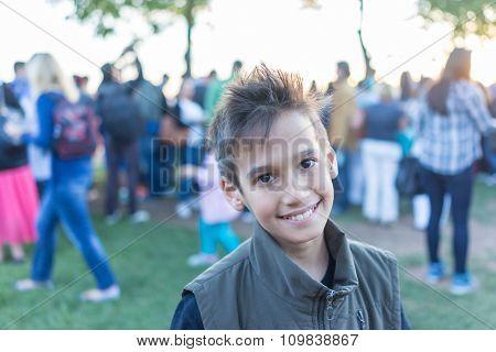 Kid standing in crowd of people