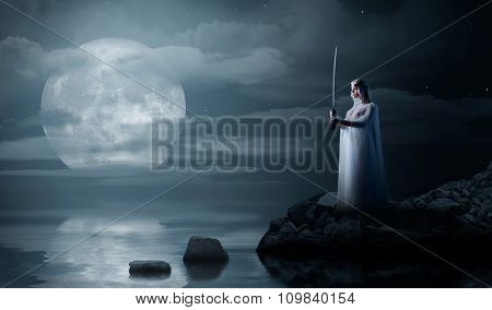 Elven girl on sea coast at night