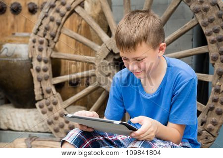 Boy used tablet PC being in the famous Panjiayuan Antique Market in Beijing