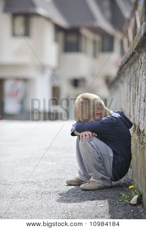 Sad Lonely Boy On Street