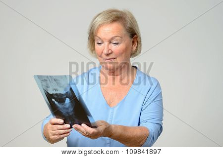 Elderly Patient Or Doctor Looking At An X-ray