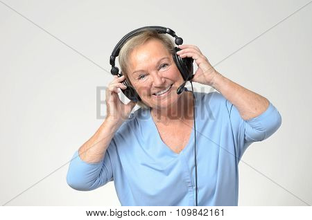 Excited Senior Woman Listening To Music