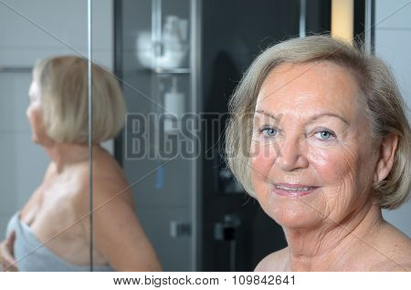 Attractive Blond Senior Woman In A Bathroom