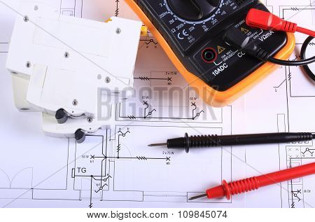 Multimeter And Electric Fuse On Construction Drawing