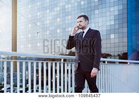 Businessman Walking On Bridge