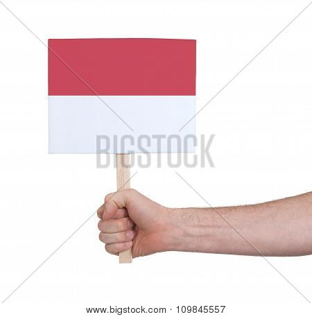 Hand Holding Small Card - Flag Of Monaco