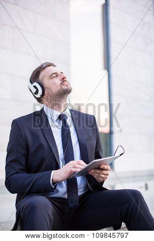 Businessman And Headphones
