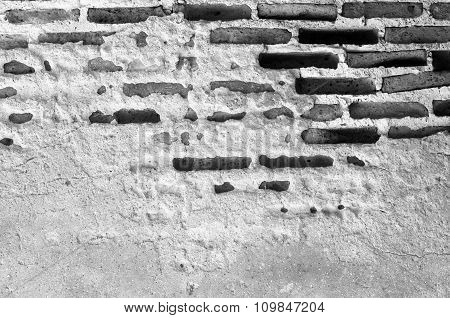 Old Brick Wall In A Background Image. White And Black Process