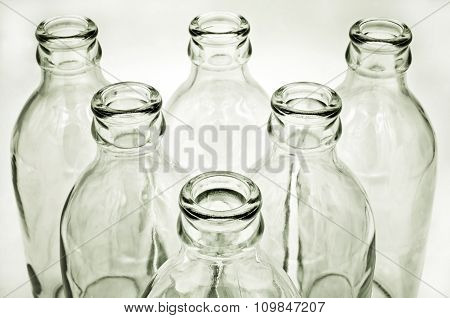 Glass bottles on white background