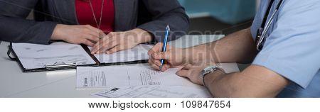 Docotr Writing Prescription For Patient