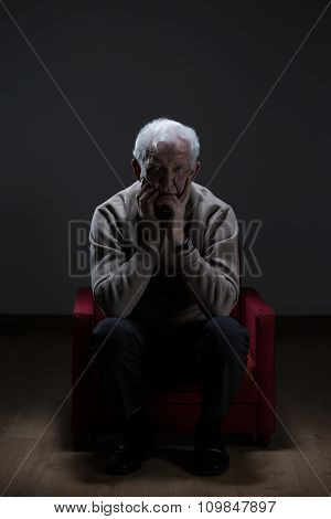 Worried Senior In Empty Room