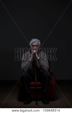 Old Worried Man With Cane