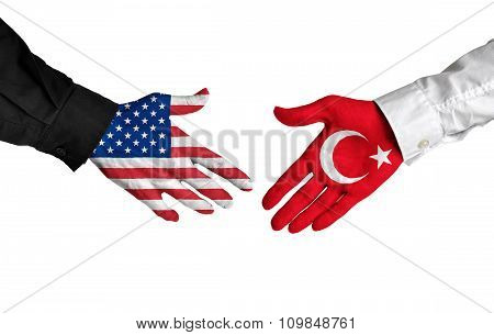 United States and Turkey leaders shaking hands on a deal agreement