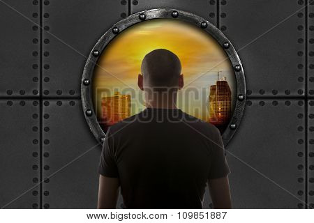The man in the bunker looks at the city. Apocalypse concept