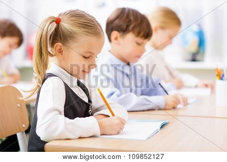 Pupils are writing in their copybooks