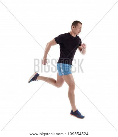 Side view of athlete running in studio
