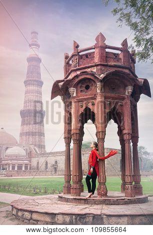 Woman In Red Near Qutub Minar Complex