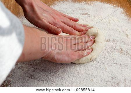 Cook rolls of pizza dough