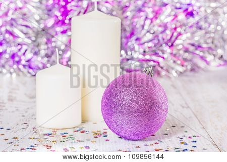 Christmas Ball And Two White Candles, Close-up