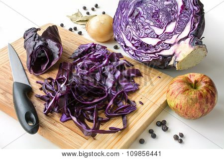 Preparing Red Cabbage With Apple, Onion, Bay Leaves And Juniper Berries