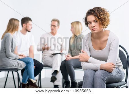 Psychologist working with group of people
