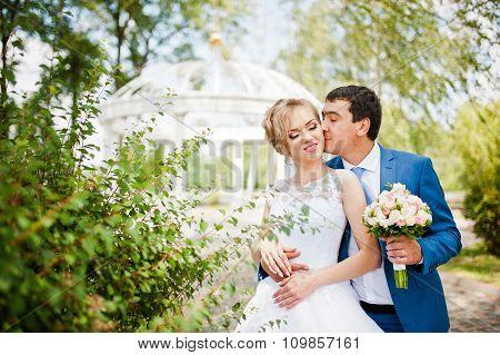 Wedding Couple Near Arch Of Love