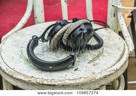 Headphones On Older White Chair