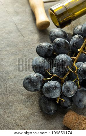 grapes and wine bottle on table