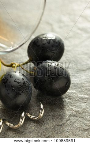 grapes and wine glass on table