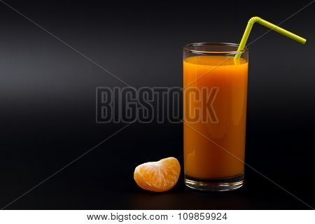 Fruits And Juice Of Tangerine On A Black Background