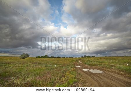 Country Road And Clouds