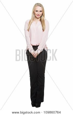 girl in pants and blous.  Isolated on white background. body language. thighs pressed standing. He h
